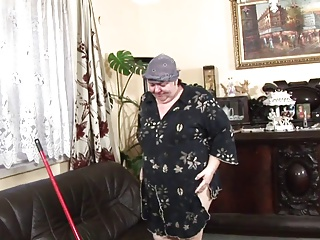 Horny MILF gets off with a broom handle before sex