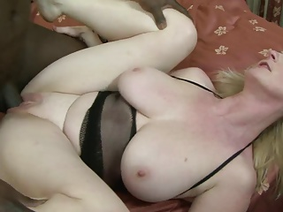 Horny MILF masturbates with a toy before black hunk bangs her